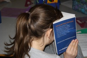 Ridge View Third Grader gets into her dictionary. (Photo by Walter Boomsma)