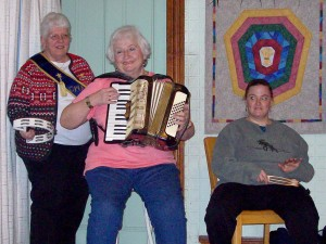 Lucille Webber, accordian player Lorraine Ouellette, and Holly Meserve