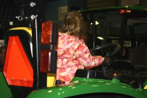 Young lady practices driving skills at the Ag Trades Expo - photo by Walter Boomsma