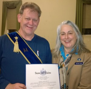 Denise Tepler, newly elected to the Maine State Legislature, presents Topsham Master Mike Labbe with the Legislative Resolve honoring Topsham Grange.
