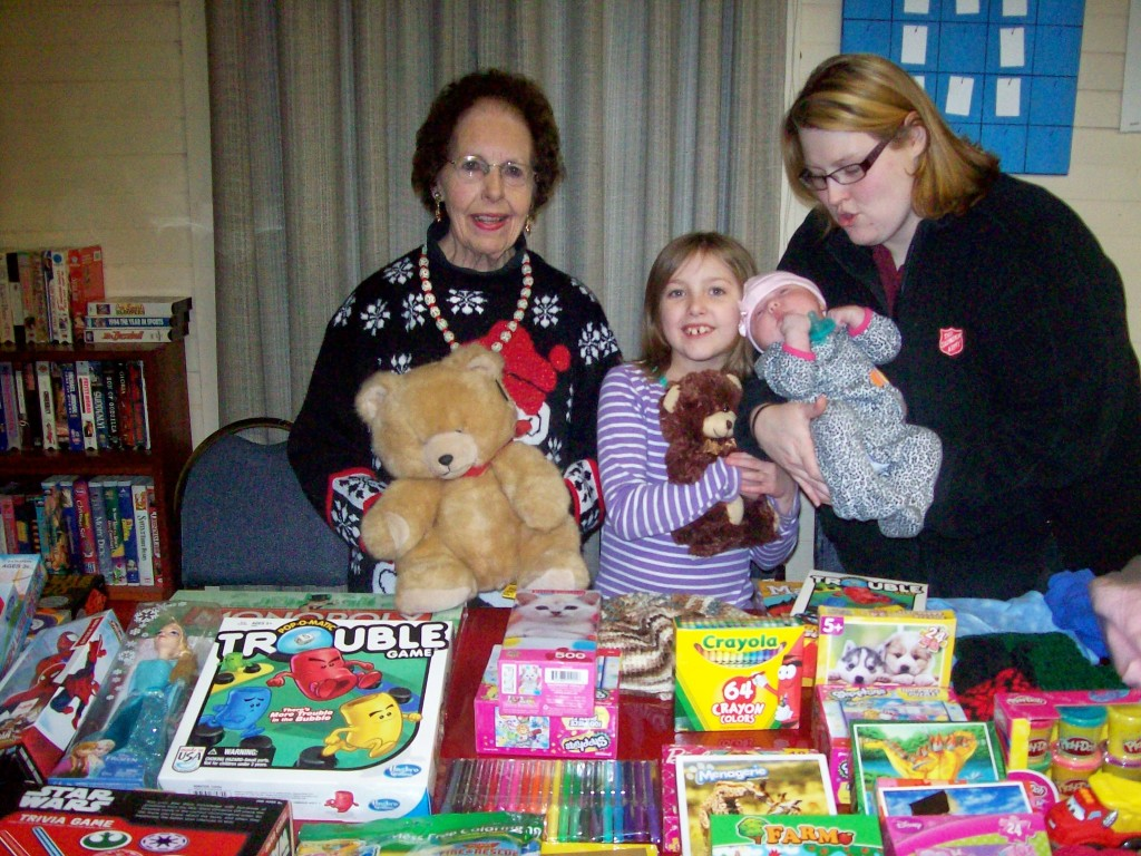 It appeared that Santa had arrived at Danville Junction Grange recently!  Two festive  tables were piled high with unwrapped games, toys, books and knit goods brought by the members for the Salvation Army Christmas Project! Pictured are Glenys Ryder, Community Service Chair and Lt. Holly Johnson and her children Livvyann and Gabriella.