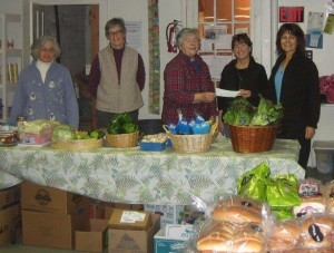 Members of Millstream Grange present donations to Helen Wilkey from Mount Vernon Area Food Bank.